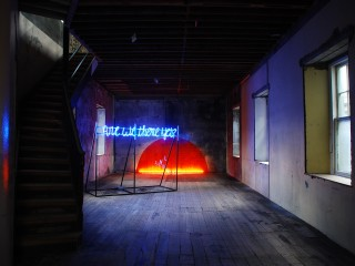 Are we there yet? Neon sign and painted mild steel. 8ft (W) x 6.3ft (H) x 3.4ft D) and Of things yet to come. Mild steel, perspex, fluorescent lights. 11ft (W) x 5.8ft